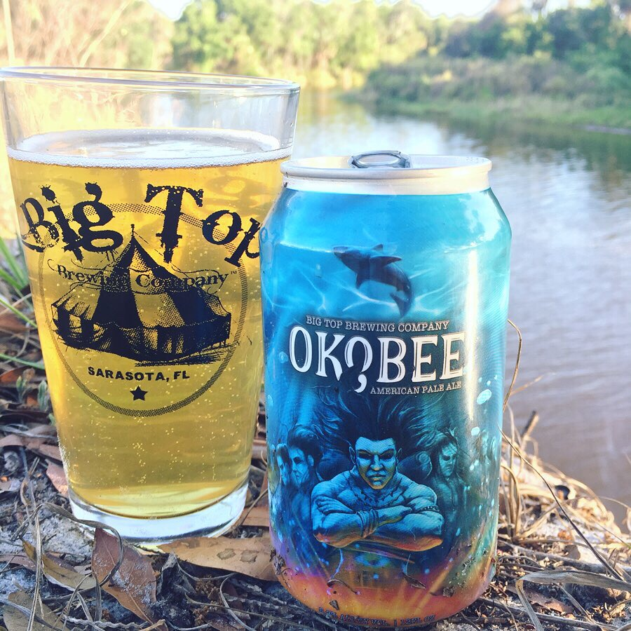 Okobee Pale Ale poured in a Big Top Brewing glass with the can by the Manatee River